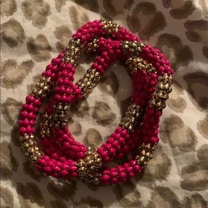 Pink and gold twisted bracelet